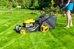 person mowing lawn
